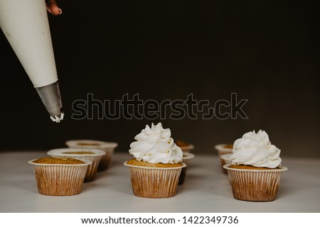 Cooking cupcakes at home. White kitchen. #1422349736