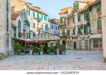 City of Split, Croatia, cafes and shops on an early morning on the Fruit Square in the Diocletians Palace section of Old Town Royalty-Free Stock Photo #1422400919