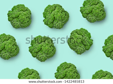 Broccoli cabbage on a colored background. Pattern of fresh broccoli cabbage. Top view of broccoli. Isolated #1422485813
