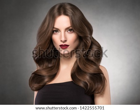 Hairstyle beautiful woman long curly brunette hair beautiful makeup young model #1422555701