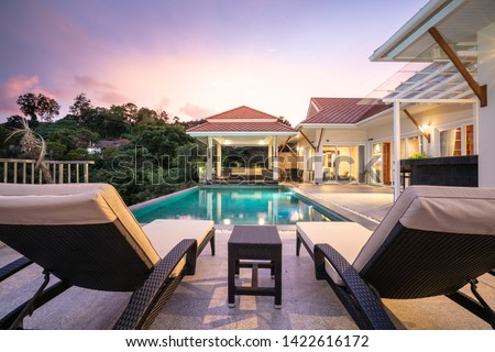 home or house Exterior design showing tropical pool villa with sun bed #1422616172