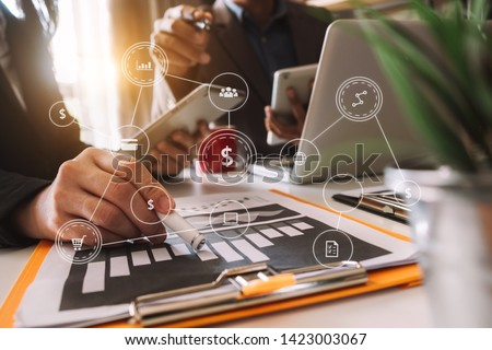 Business team meeting. professional investor working new start up project. Finance task. with smart phone and laptop and digital tablet computer  in morning light  #1423003067