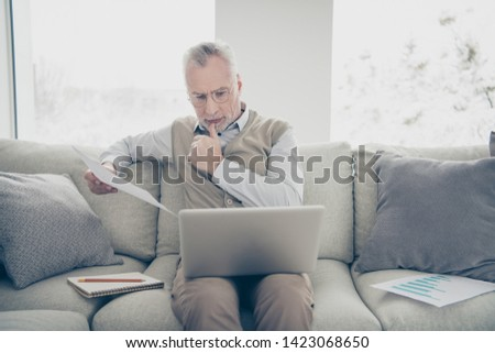 Close up photo amazing he him his aged man hands arms notebook search analyzer check compare information charts stats wear white shirt waistcoat pants sit cozy divan flat house living room indoors
