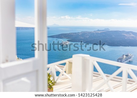 Beautiful sea view from a luxury hotel caldera, cruise ships and volcano. White architecture on Santorini island, Greece. White door and entrance of resort, freedom and adventure template. #1423125428