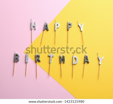 Flat lay composition with birthday candles on color background #1423125980