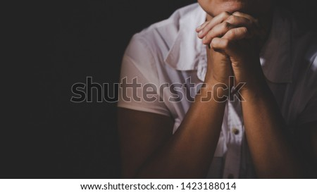 Christian life crisis prayer to god. Woman Pray for god blessing to wishing have a better life. woman hands praying to god with the bible. begging for forgiveness and believe in goodness. #1423188014