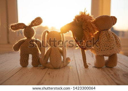 Children's animal stuffed toys bunny and teddy family on wooden floor in kids room. #1423300064