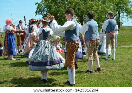 Kourim / Czech Republic - June 9 2019: Czech folklore - Young people in folk clothing, dancing traditional czech dances and singing to celebrate Pentecost (Letnice. Svatodusni svatky) #1423316204