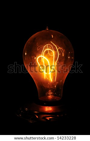 Edison light bulb with looping carbon filament. #14233228