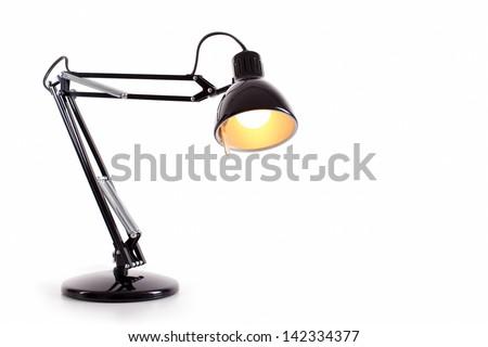 Vintage black desk lamp isolated on white Royalty-Free Stock Photo #142334377