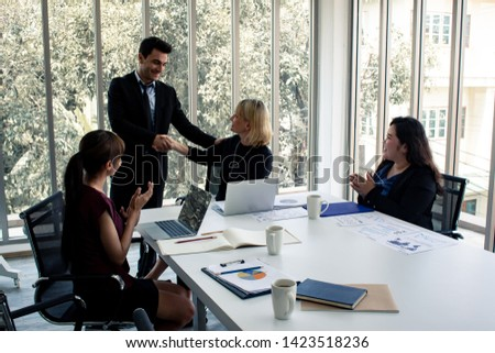 Men with explaining the information in meeting room. Concept of meeting room where staff are planning and looking for ways to do business. Concept business in meeting room. #1423518236