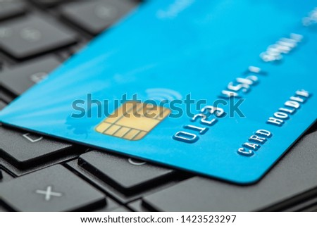 Credit card on keyboard with laptop. Online payment for purchases from online stores. Online shopping. #1423523297