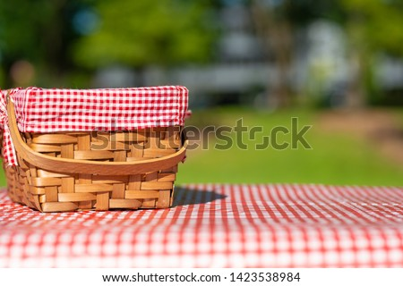 picnic basket on a table with a red tablecloth. Summer mood. relaxation. holidays