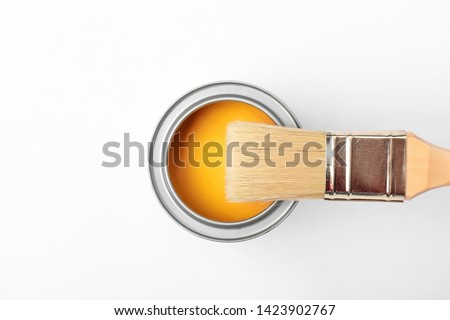 Can of paint and brush on white background #1423902767