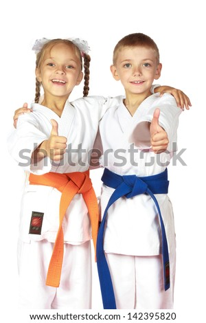 Happy boy and girl athletes karate champions Royalty-Free Stock Photo #142395820