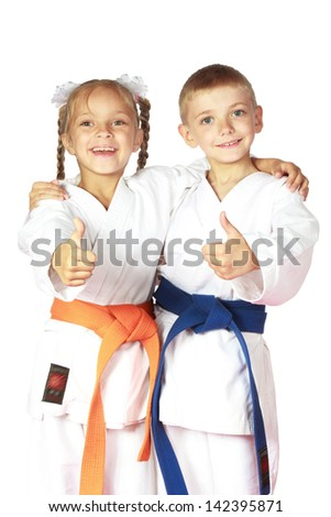 Happy boy and girl athletes karate champions #142395871