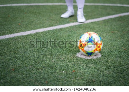 Bangkok / Thailand - June 2019 : A football player is training on turf ground with Asics DS light 3 football boot, he is practice for penalty kick shooting. Selected focus. #1424040206