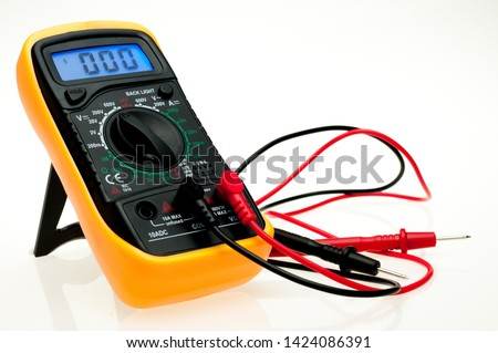 Digital multimeter with probes and blue backlit display on a white background #1424086391