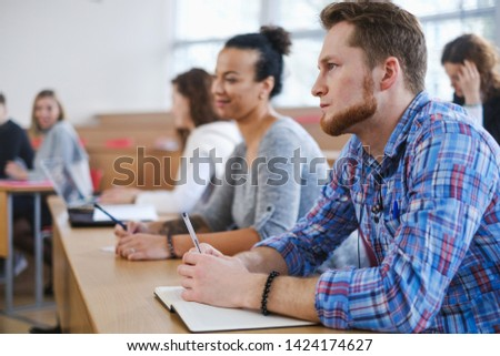 Multinational group of students in an auditorium #1424174627