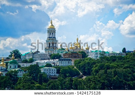 Kyiv city scape with with Kiev Pechersk Lavra monastery and the Motherland Monument, Ukraine. Kiev Pechersk Lavra or the Kiev Monastery of the Caves #1424175128