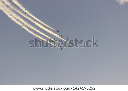 Airplanes performing an aerial acrobatics exhibition, Eagle patrol, San Javier Base, Murcia, Spain. Photo with space for advertising, blank space for your promotional text or advertising content,