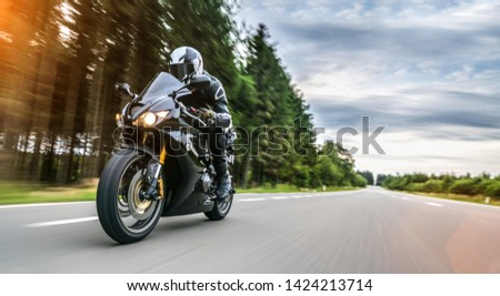 motorbike on the road driving fast. having fun on the empty highway on a motorcycle  journey. copyspace for your individual text. #1424213714