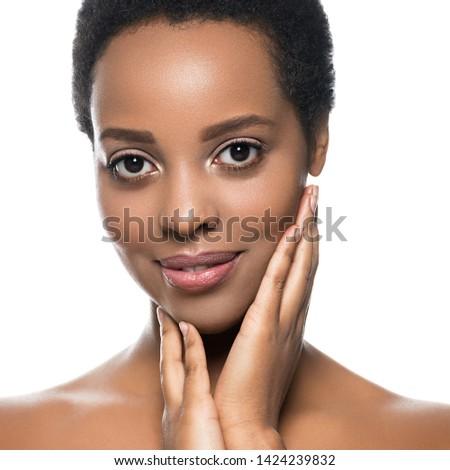 Black skin woman beautyface healthy skin closeup isolated on white #1424239832