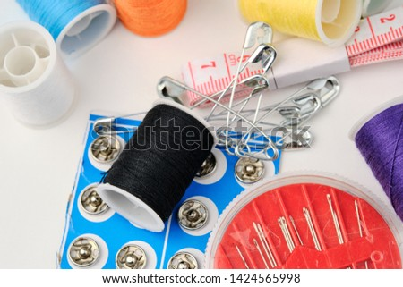 a set of sewing accessories for repairing clothes on a white background close-up #1424565998