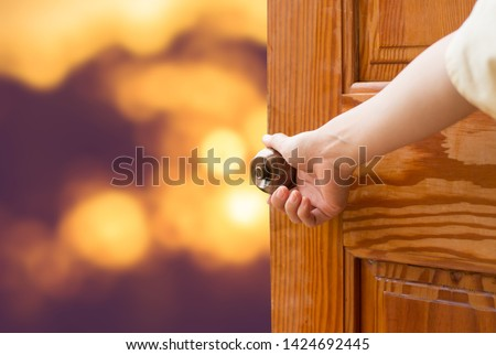 Women hand open door knob or opening the door,grand opening,Close up hand open door. #1424692445