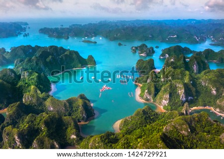 Aerial view of Halong pearl museum and rock island, Halong Bay, Vietnam, Southeast Asia. UNESCO World Heritage Site. Junk boat cruise to Ha Long Bay. Popular landmark, famous destination of Vietnam #1424729921