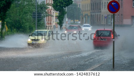 Flooding of the road in heavy rain Royalty-Free Stock Photo #1424837612