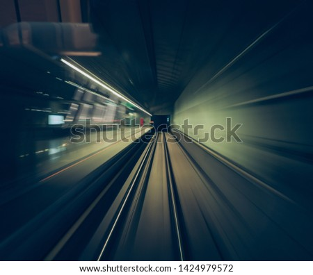 a fast movement of a train through railway tunnels captured from inside the cabin of a train #1424979572