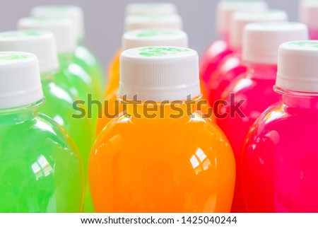 Colourful juice and Electrolyte drink in bottle for healthy and sport man and Athlete
