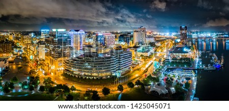 Aerial panorama of Norfolk Virginia by night. Norfolk is the second-most populous city in Virginia after neighboring Virginia Beach and the host of the largest navy base in the world. #1425045071
