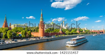 Moscow Kremlin in summer, Russia. Famous Moscow Kremlin is a top tourist attraction of city. Panoramic view of the beautiful Moscow landmark. Cityscape of the Moscow center and ship on Moskva River. #1425151457