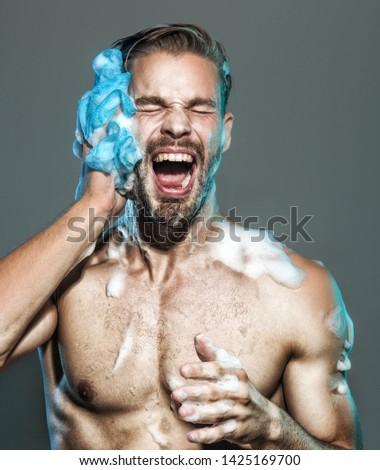 Naked man taking shower with foam. Fitness handsome man taking shower in morning. Muscular fitness bodybuilder taking shower after training. Man washing body in shower. Sexy man washing in bathroom. #1425169700
