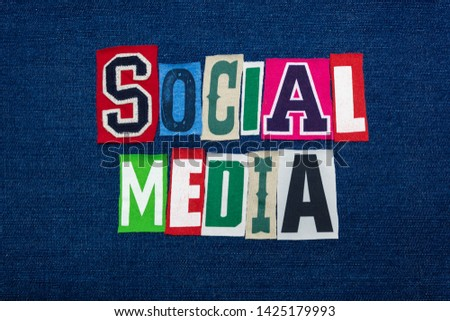 SOCIAL MEDIA collage of word text, multi colored fabric on blue denim, personal online presence concept, horizontal aspect