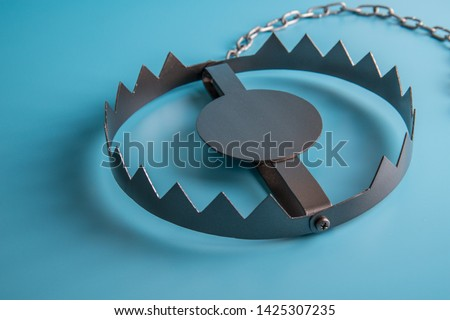 Metal bear trap. Business concept idea. Situations, risk setting. Royalty-Free Stock Photo #1425307235