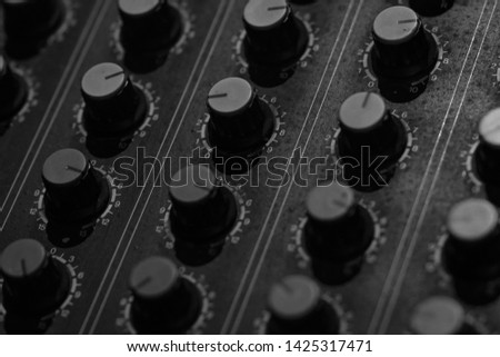 Audio sound mixer console. Sound mixing desk. Music mixer control panel in recording studio. Audio mixing console and adjusting knob. Sound engineer. Sound mixer control radio broadcasting. #1425317471