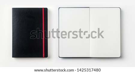 Design concept - top view of black notebook with red binder and pen isolated on white background for mockup. real photo, not 3D render #1425317480