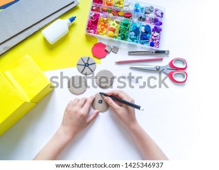 School bus made of cardboard. DIY children's pencil case for stationery paper craft. Back to school. Children's garden. White background #1425346937