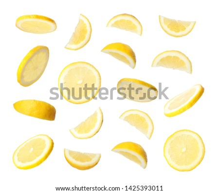 Set of flying cut fresh juicy lemon on white background #1425393011
