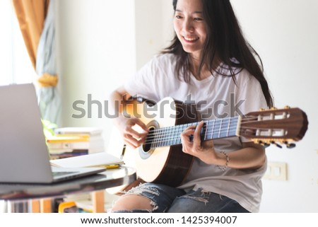 artist songwriter thinking writing notes,lyrics in book at studio.man playing live acoustic guitar.concept for musician creative.composer in work process.people relaxing time with instrument #1425394007