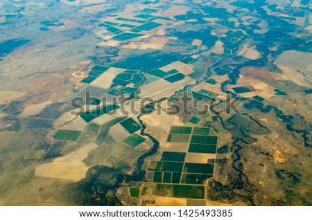 DARLING DOWNS, QUEENSLAND, AUSTRALIA: Patchwork pattern of crops in prime agricultural land on the western Downs of southern Queensland with shelter belts, reserves and watercourses. Royalty-Free Stock Photo #1425493385