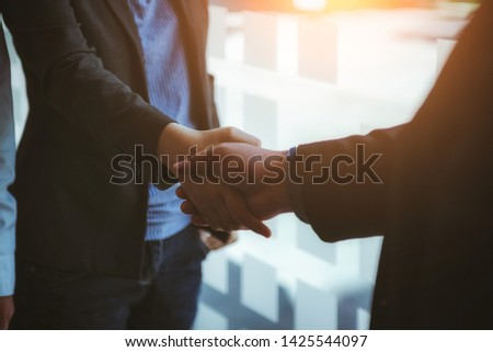 Business people shaking hands after finised contract papers making at office. Business successful contract concept. #1425544097
