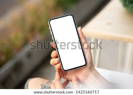 Mockup image screen cell phone.men hand holding texting using mobile at desk.with copy space,white blank screen for text.concept for contact business,people communication,technology electronic device #1425560717