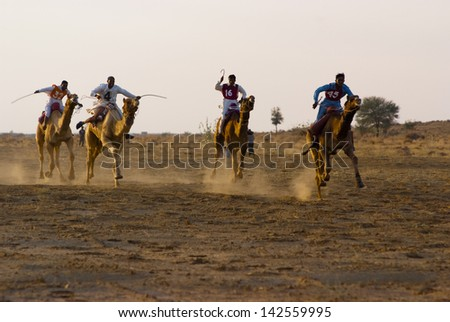 JAISALMER, INDIA - FEB 25:  Camel racing on Feb 25, 2013 in Jaisalmer, India.  The event is part of the Desert Festival held in winter to attract both domestic and international tourists. #142559995