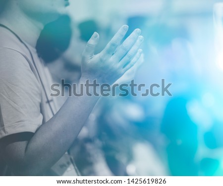 Man praying and worship to GOD in Church.Man raised hands and pray to GOD.Hand praying and palmup,Concept Praise and worship with faith, spirituality and Surrender. #1425619826