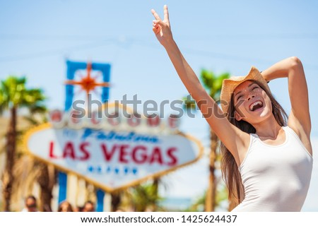 Las Vegas sign USA vacation fun american tourist cowgirl woman on road trip travel screaming of joy with cowboy hat on The Strip. Welcome to Fabulous Las Vegas, Nevada, Summer adventure.