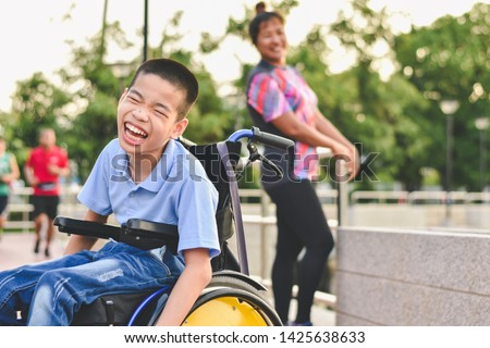 Disabled child on wheelchair is play and learn in the outdoor park like other people, Life in the education age of special children, Happy disability kid concept. #1425638633